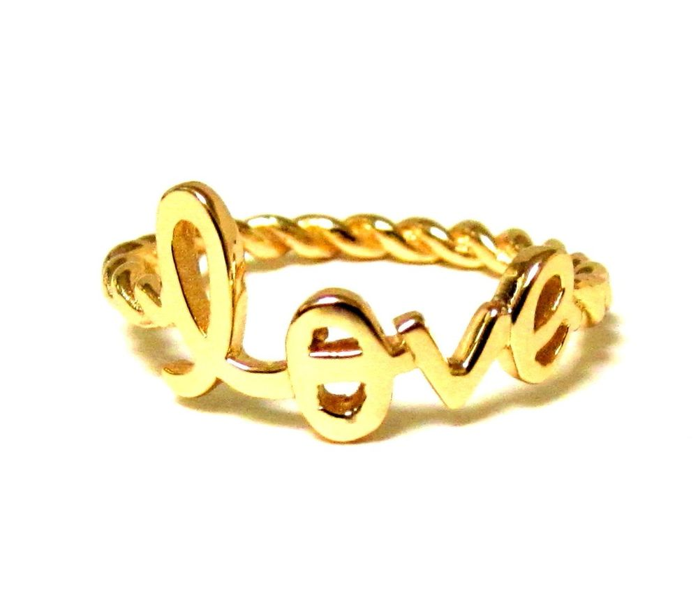Love ring with twisted rope band in 14 kt gold over 925 sterling silver