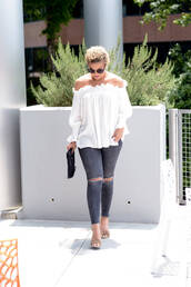 fashionably lo,blogger,bag,sunglasses,off the shoulder,white top,clutch,grey jeans,skinny jeans,ripped jeans,blouse,white off shoulder top,off the shoulder top,peasant top,long sleeves,fringe shoes,sandals,sandal heels,high heel sandals