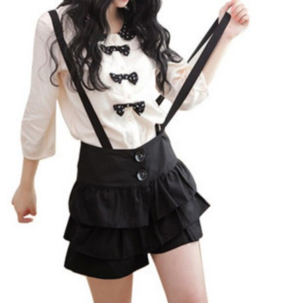 pants long sleeved blouse black bows white they are black with suspenders ruffles