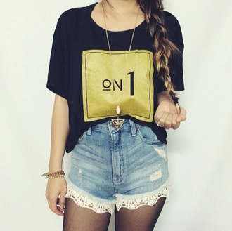 shirt on 1 tshirt black and gold on. 1 chanel no. 1 like lrg clothing department