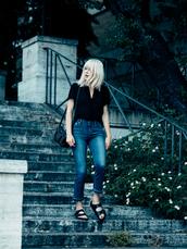 fire on the head,blogger,blonde hair,skinny jeans,black blouse,slide shoes,platinum hair,black slides