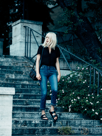 fire on the head blogger blonde hair skinny jeans black blouse slide shoes platinum hair black slides