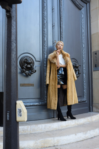 the haute pursuit blogger faux fur coat thigh high boots vinyl vinyl skirt long coat mini skirt black skirt over the knee boots over the knee high heels boots black boots camel camel coat camel fluffy coat fur collar coat fuzzy coat fluffy camel long coat winter outfits