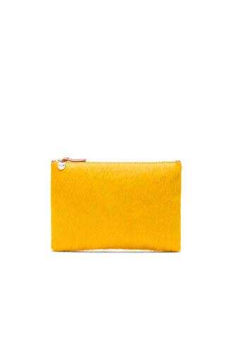 clutch mustard bag