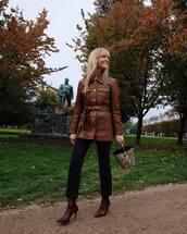 jacket,leather jacket,black denim,jeans,cropped jeans,handbag,snake print,sock boots,high heels boots
