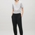Trousers with pleated hems - Black - Trousers - COS US