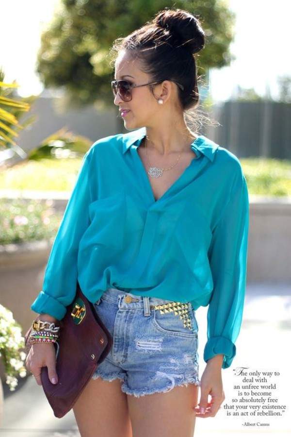blouse blue studded denim shorts envelope clutch bag shorts jewels bracelets earrings necklace sunglasses spiked jeans fashion