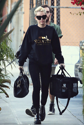 sweater,gold,black,writing,miley cyrus,cyrus,street,style,jumper,pullover,shirt,homies,crewneck,top,streetstyle,DrMartens,platform shoes,bag,sunglasses,shoes,graphic sweatshirt,cat eye