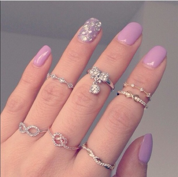 Pink nails with diamonds on ring finger
