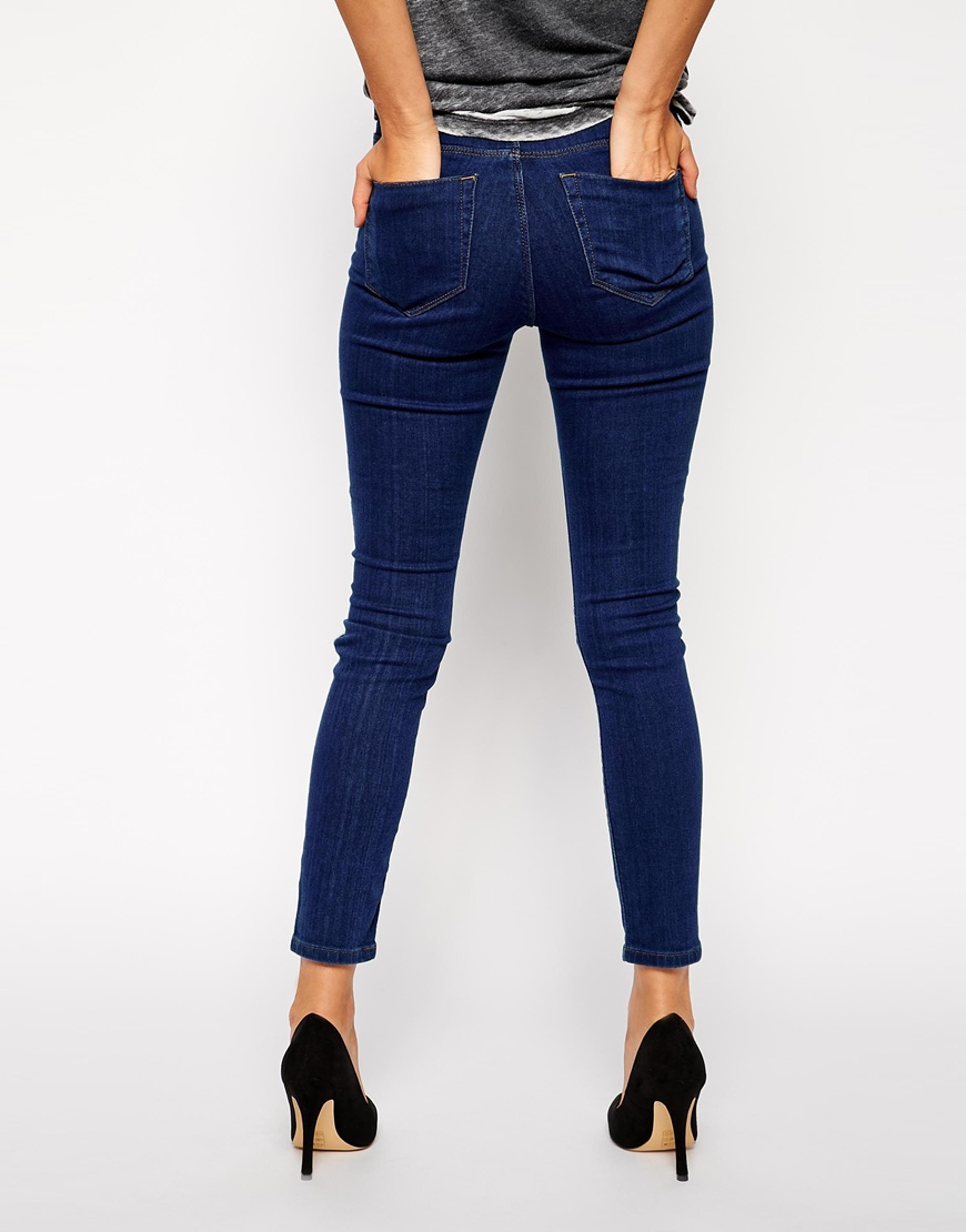 ASOS Ridley High Waist Ultra Skinny Ankle Grazer Jeans in Rich Dark Wash Blue with Thigh Rips and Busted Knees at asos.com