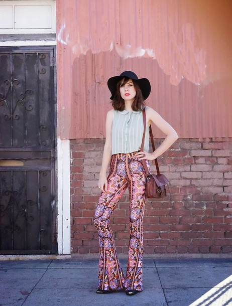 a fashion nerd blogger 70s style floppy hat blouse printed pants hippie hat pants bag black hat