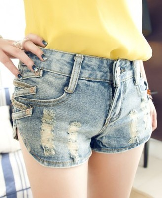 Ripped denim shorts with cross sides
