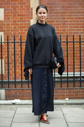sweater,embroidered bag,fashion week street style,fashion week 2016,fashion week,long dress,london fashion week 2016,blue dress,maxi dress,shirt dress,slit dress,high heels,animal print,leopard print high heels,sweatshirt,black sweatshirt,bag,embroidered,fall outfits,streetstyle