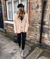 sweater,cardigan,oversized cardigan,black blouse,skinny jeans,jeans,ankle boots,snake print,handbag,cap