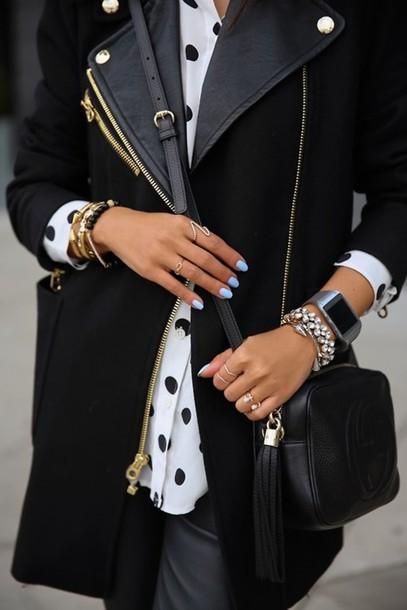coat nail polish knuckle ring crossbody bag polka dots black and white bag
