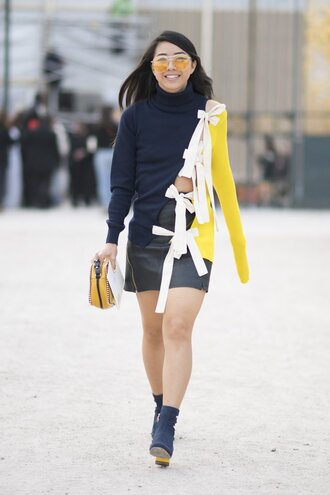 sweater blue boots fashion week street style fashion week 2016 fashion week paris fashion week 2016 multicolor bow sunglasses yellow skirt mini skirt black skirt black leather skirt leather skirt boots ankle boots streetstyle bag yellow bag blouse