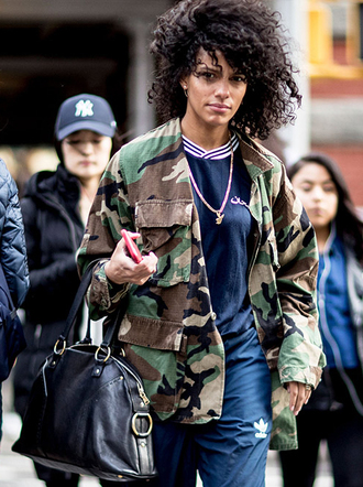 jacket nyfw 2017 fashion week 2017 fashion week streetstyle camouflage camo jacket bag black bag sweatshirt top blue top navy sweatpants joggers joggers pants athleisure