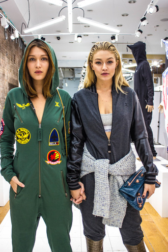 romper hadid sisters gigi hadid bella hadid celebrity style streetstyle brown boots bag blue bag pullover grey sweater sweater calvin klein balenciaga onesie green jumpsuit clutch