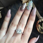 jewels,hand jewelry,jewelry,gemstone ring,ring,engagement ring,wedding ring,diamonds,diamond ring,silver ring,bling