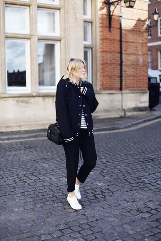 into the fold blogger bag black pants baseball jacket striped top