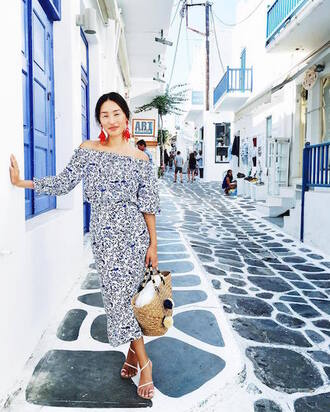 le fashion image blogger jewels dress bag basket bag beach bag pom pom bag pom poms earrings off the shoulder dress off the shoulder printed sweater printed dress midi dress sandals sandal heels high heel sandals white sandals bardot dress puffed sleeves