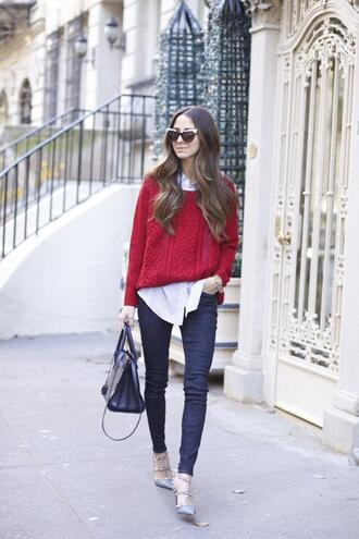 something navy blogger cable knit red sweater skinny jeans white shirt cat eye handbag pointed toe jeans shoes shirt sweater sunglasses bag red cable knit sweater denim blue jeans valentino rockstud studded shoes