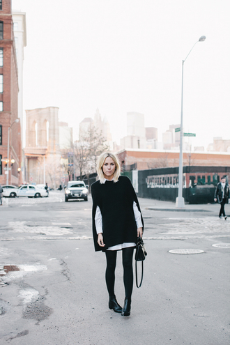 damsel in dior blogger white shirt cape dress tights shoes