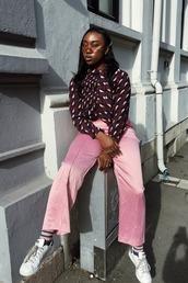 pants,wide-leg pants,pink,pink pants,silk,shirt,sunglasses,sneakers,white sneakers,low top sneakers