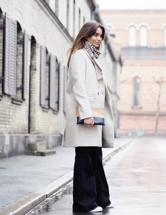 by funda blogger white coat flare pants coat scarf sweater jeans bag shoes flare jeans finery london