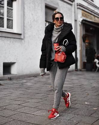 jacket black jacket sweater grey sweater pants grey pants shoes red shoes
