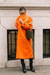 coat,long coat,orange coat,green bag boots,black boots,sunglasses,bag