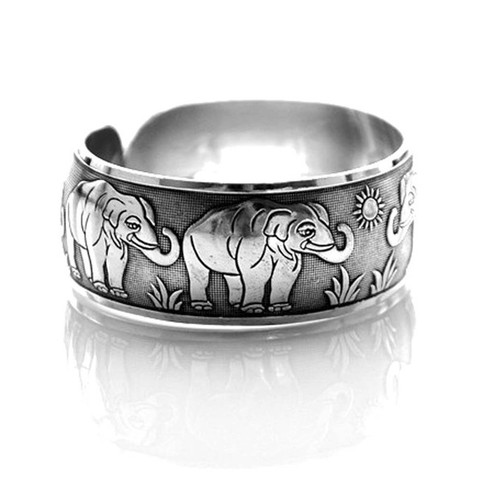 Elephant Parade Animal Themed Bangle Cuff Bracelet in Silver · DOTOLY · The Animal Wrap Rings and Jewelry Store