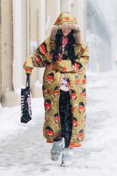 coat,hood,tumblr,nyfw 2017,fashion week 2017,fashion week,streetstyle,printed coat,printed long coat,long coat,pants,black pants,bag,tote bag,boots,metal,metallic,metallic shoes,winter outfits,winter boots,winter look