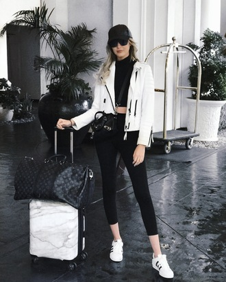 carly cristman blogger jacket top leggings shoes sweater cap white jacket sneakers louis vuitton bag travel bag