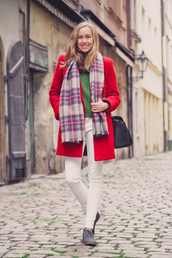 a cup of style,blogger,bag,red coat,tartan scarf,skinny pants,coat,sweater,top,jeans,shoes,scarf