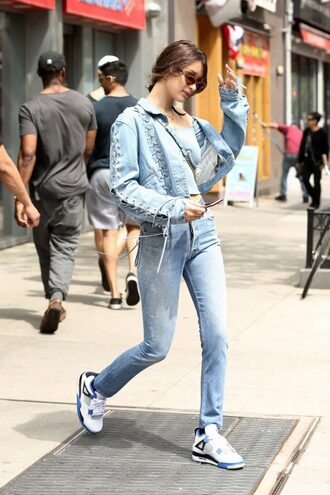 top denim jacket denim jacket jeans bella hadid sneakers streetstyle model off-duty