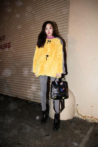 jacket nyfw 2017 fashion week 2017 fashion week streetstyle yellow yellow jacket leggings grey leggings black backpack backpack boots black boots ankle boots