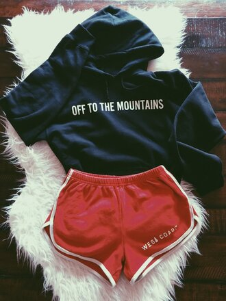 top off to the mountains dark blue blue sweater red running shorts