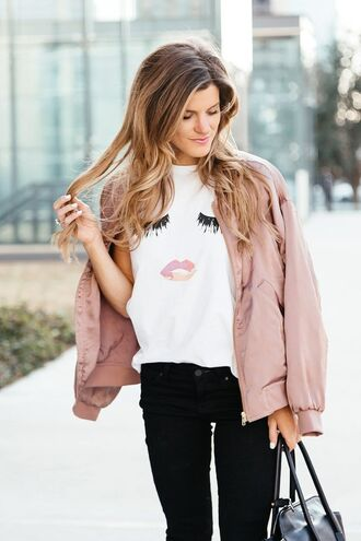 jacket white graphic shirt pink bomber jacket black jeans blogger