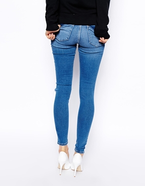 ASOS   ASOS Ridley High Waist Ultra Skinny Jeans in Busted Blue with Busted Knee at ASOS