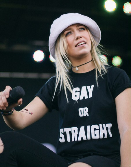 top black top t-shirt bucket hat white hat white bucket hat gay or straight black shirt black tee slogan tonight alive jenna mcdougall nose piercing nose ring nosering blonde hair warped tour warped tour fashion choker necklace gay pride gay gay shirts statement tees statement statement shirts slogan top