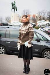 hat,earmuffs,sweater,christmas sweater,christmas,brown sweater,oversized sweater,oversized,skirt,midi skirt,black skirt,tights,boots,black boots,ankle boots,gloves,winter outfits,winter look,knitted gloves