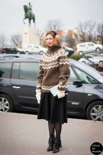 hat earmuffs sweater christmas sweater christmas brown sweater oversized sweater oversized skirt midi skirt black skirt tights boots black boots ankle boots gloves winter outfits winter look knitted gloves