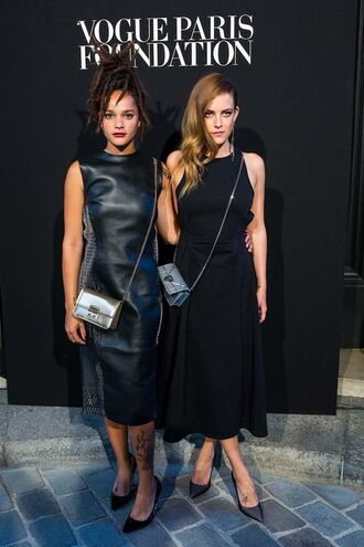 dress sasha lane riley keough celebrity style celebrity actress midi dress black dress black midi dress leather dress a line dress bag silver bag metallic bag crossbody bag pumps pointed toe pumps black pumps high heel pumps sleeveless dress