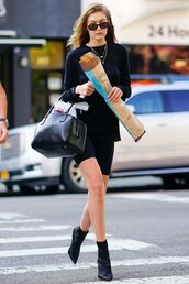 shoes,gigi hadid,streetstyle,model off-duty,ankle boots,all black everything,top,shorts