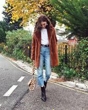 coat,faux fur coat,brown coat,cropped jeans,high waisted jeans,belt,ankle boots,black boots,shoulder bag,fluffy,leopard print,white t-shirt,earrings