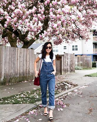 jeans white t-shirt overalls denim denim overalls black sandals sandals white top bag shoulder bag sunglasses