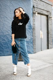 caradisclothed,blogger,sweater,skirt,socks,shoes,bag,button up denim skirt,button up skirt,black sweater,quote on it,clutch,wedges