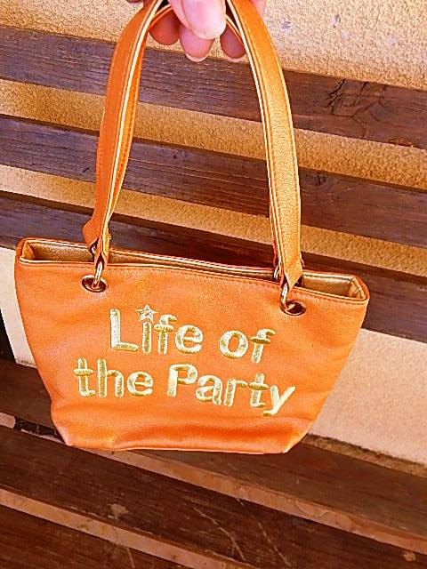 Life of the party small orange and gold purse