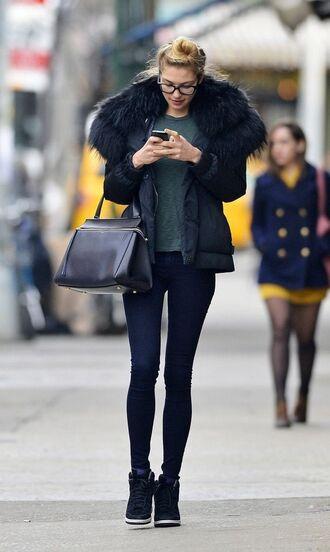 jacket glasses black puffer jacket skinny jeans green sweater black sneakers blogger